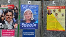 France. Henin Beaumont le 2015/12/06Marine Le Pen a Henin Beaumont vote et resultats du 1er tour des elections regionales.Affiches electorales a Henin Beaumont  affiche de Marine Le Pen et du Front de Gauche et de Lutte Ouvriere